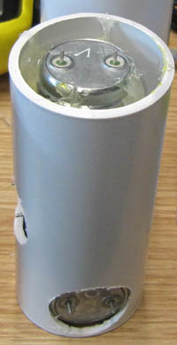 Three geophone sensors are held in position inside a plastic tube ready for inserting in the main enclosure