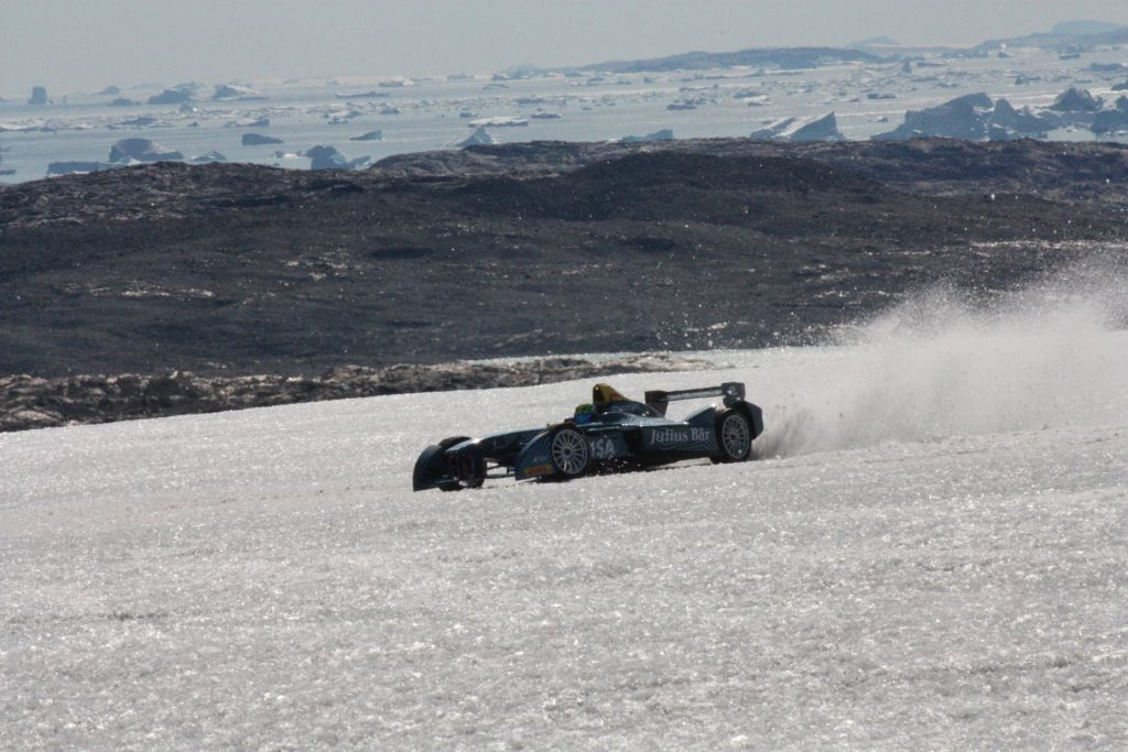 Formula E driving on a glacier in Greenland. This photo shows the icebergs in the sea - like the one we are tracking from here. Photo courtesy Formula E team.